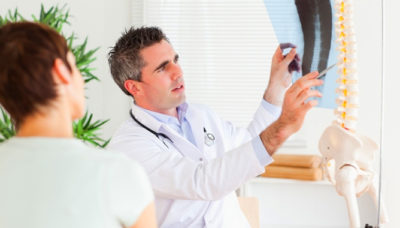 Is it possible to run a patient with a herniated lumbar spine?