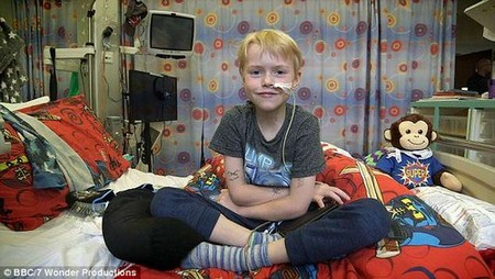 Schoolboy Max Johnson, who had cardiomyopathy, spent seven months waiting for a donor heart before undergoing a nine-hour operation (thought to be pictured recovering in hospital)