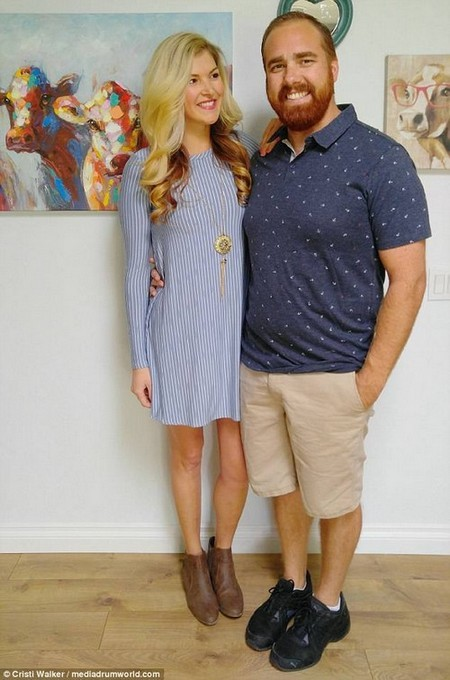 Cristi, pictured recently with her husband, says many people don't recognize her now
