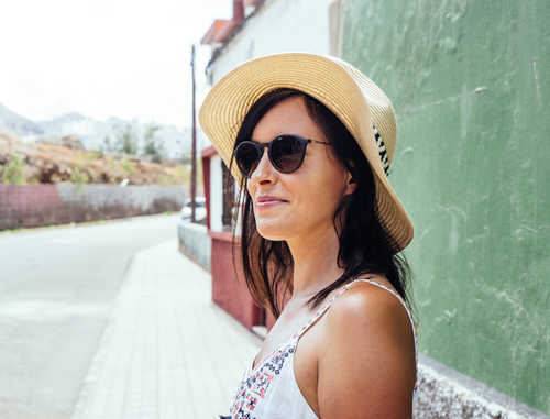 On sunny days in summer, people predisposed to hyperpigmentation are better off going out in hats.